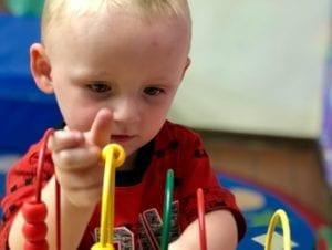 a child manipulating a STEM toy